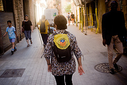 September 11, 2017 - Barcelona, Catalonia, Spain - A woman walks Barcelona streets with a estelada flag (sign of Catalan independence) reading 'Catalonia New Esatate in Europe'. Catalan government aims to celebrate a referendum on independence next first october. (Credit Image: © Jordi Boixareu via ZUMA Wire)