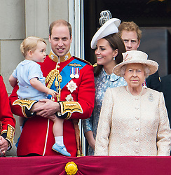 © London News Pictures. 13/06/2015. London, UK. L to R Prince George of Cambridge being held up by his father Prince William, Catherine Duchess of Cambridge, Queen Elizabeth II and Prince Harry.  Members of the Royal Family on the balcony of Buckingham Palace during the annual Trooping the Colour Ceremony in central London. The event marks the queens official birthday. .Photo credit: Ben Cawthra/LNP