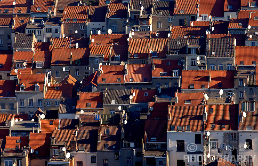 Brussels cityscape and skyline showing rows and rows of red roofed houses dotted with satellite dishes in Brussels. (Photo © Jock Fistick)