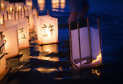 A paper lantern catches fire as it floats out onto the waters of Green Lake during the annual From Hiroshima to Hope event, which observes the anniversary of the Hiroshima and Nagasaki atomic bombings. <br /> <br /> Lindsey Wasson / The Seattle Times