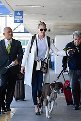 EXCLUSIVE: Kate Upton shows off her new Celine bag as she departs LAX with her dog Harley. 16 May 2017 Pictured: Kate Upton. Photo credit: MEGA TheMegaAgency.com +1 888 505 6342