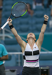March 25, 2019 - Miami Gardens, FL, USA - Simona Halep, of Romania, reacts after scoring against Venus Williams, of the United States, during their match at the Miami Open tennis tournament on Monday, March 25, 2019 at Hard Rock Stadium in Miami Gardens, Fla. (Credit Image: © Matias J. Ocner/Miami Herald/TNS via ZUMA Wire)