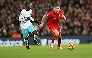Adam Lallana of Liverpool and Pedro Obiang of West Ham United during the Premier League match at Anfield Stadium, Liverpool. Picture date: December 11th, 2016.Photo credit should read: Lynne Cameron/Sportimage