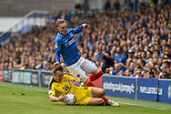 Oxford United Defender, Tony McMahon (29) and Portsmouth Midfielder, Ronan Curtis (11) during the EFL Sky Bet League 1 match between Portsmouth and Oxford United at Fratton Park, Portsmouth, England on 18 August 2018.
