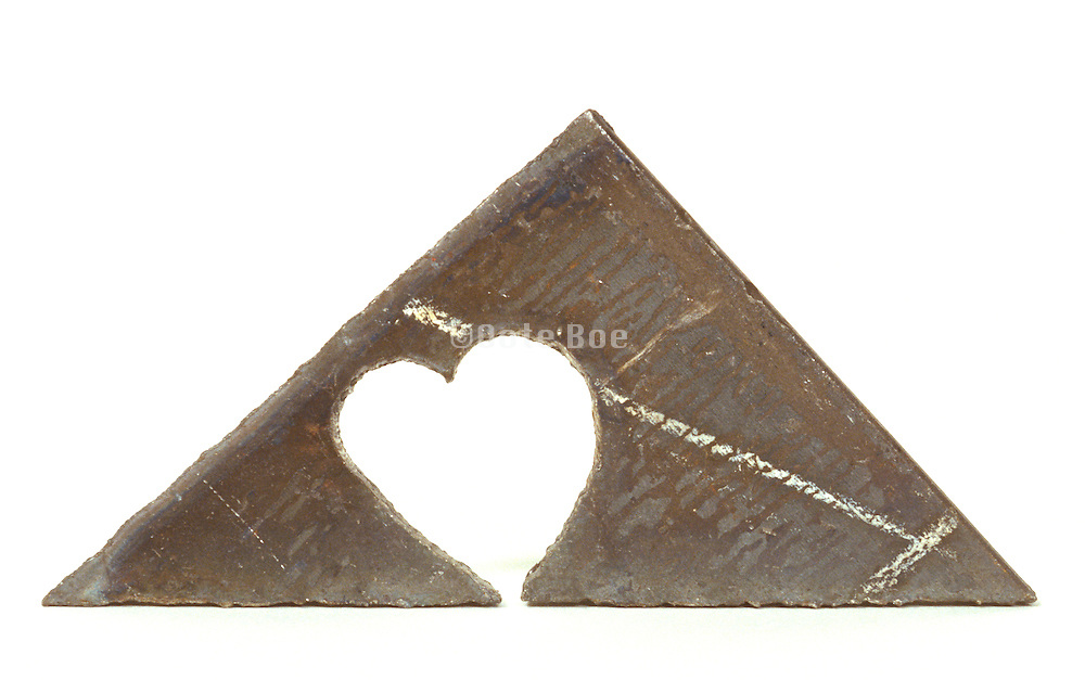 piece of metal with cut out heart form