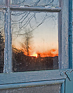 I was drawn to the reflected sunset in the antique pane of glass.
