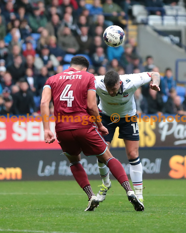 Bolton Wanderers striker Gary Madine (14) heads towards the goal during the Sky Bet League 1 match between Bolton Wanderers and Port Vale at the Macron Stadium in Bolton. October 29, 2016.<br /> Nigel Pitts-Drake / Telephoto Images<br /> +44 7967 642437