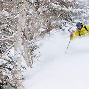 Forrest Jillson is blurred against the snow flakes of a huge late-season winter storm.