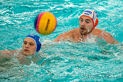 Jorn Winkelhorst of the Netherlands in action against Luca GeorgescuVlad of Romania during the Olympic qualifying tournament. The Dutch water polo players are on the hunt for a starting ticket for the Olympic Games on February 16, 2021 in Rotterdam
