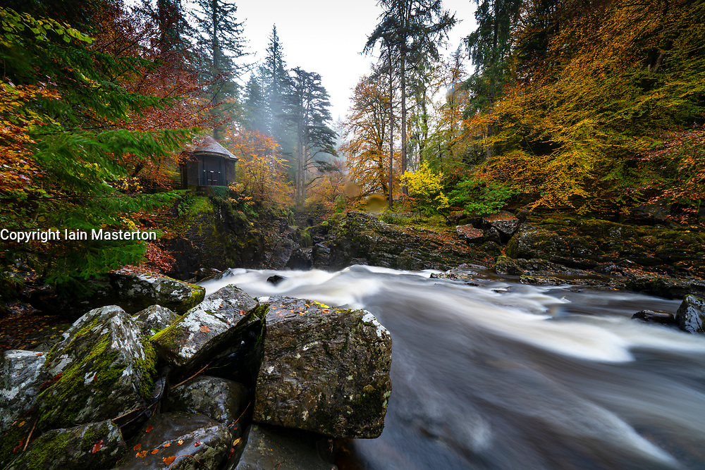 Dunkeld, Scotland, UK. 19 October 2020. Autumn colours at their best at The Hermitage in Perthshire today. The River Braan cascade and stone bridge are a favourite scenic spot for walkers. Iain Masterton/Alamy Live News