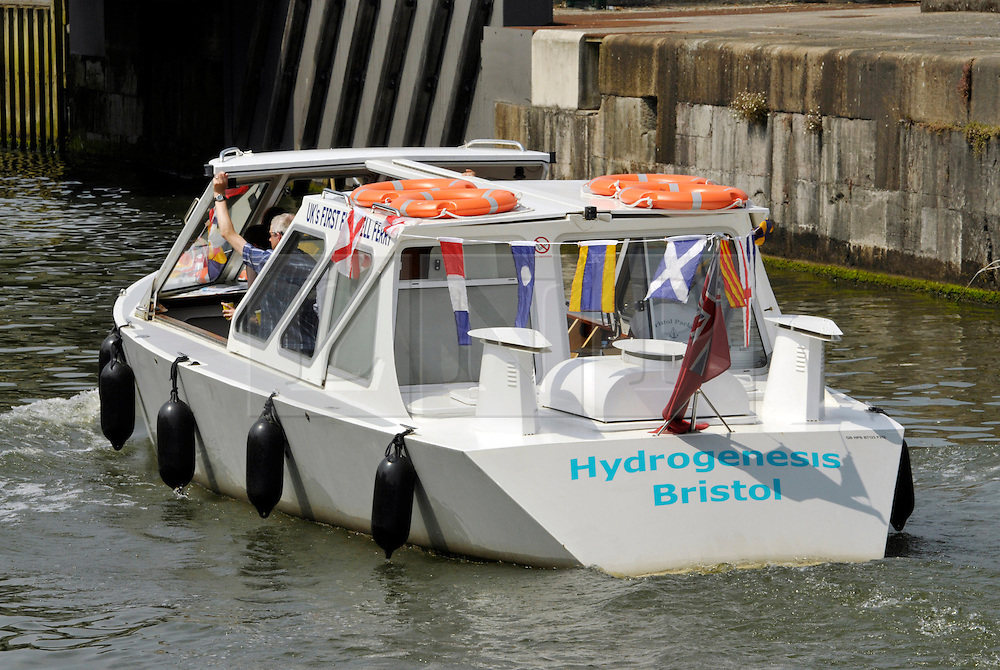 © Licensed to London News Pictures.  18/07/2013. Bristol, UK.  18 July 2013.  Hydrogenesis, the UK's first hydrogen powered ferry operating in Bristol docks.  The ferry is operated by Bristol Hydrogen Boats, a consortium of the directors of No: 7 Boat Trips, the Bristol Packet and Auriga Energy which developed the fuel cell system, while Air Products supplied the hydrogen and refuelling station.<br /> Photo credit : Simon Chapman/LNP