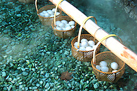 """Onsen Eggs -  Onsen tomago are cooked in hot springs. Since the eggs are slowly cooked in hot water of about 70-75 Celsius (158-167 Fahrenheit), the egg whites are soft and egg yolks are slightly hardened. Onsen tamago is sometimes  served as part of a  Japanese style breakfast in hot springs towns such as Kusatsu.  Otherwise they are local snacks and a """"must"""" for many Japanese who visit these towns."""