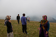 Yilmaz Civelek (centre), Muazzez Kocek (left) walk with friends near their village of Alaca Yaylası, high in Turkey's northern Pontic mountains. Villagers communicate using a language of whistling across the surrounding hills.