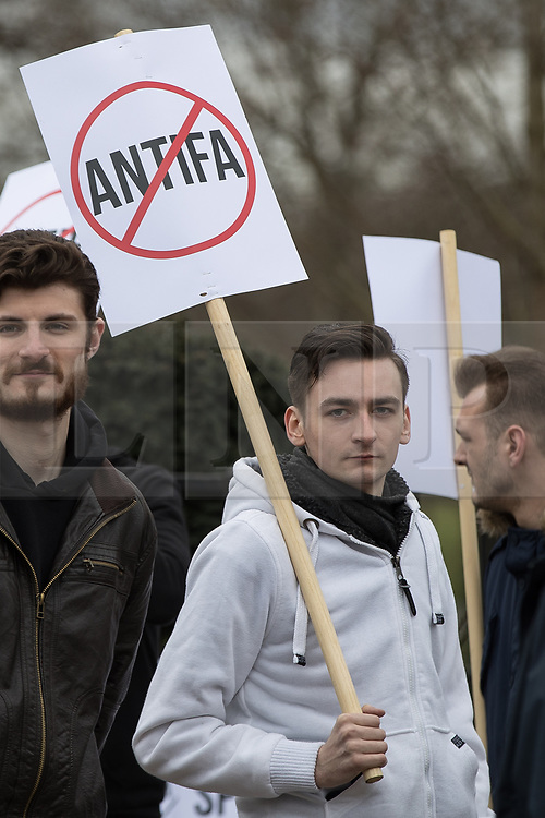 """© Licensed to London News Pictures. 11/03/2018. London, UK. An alt-right supporter with an anti antifa placard .Alt right group Generation Identity and other far-right groups hold a demonstration at Speakers' Corner in Hyde Park , opposed by antifascists . Generation Identity supporters Martin Sellner and Brittany Pettibone were due to speak at the demo but were arrested and detained by police when they arrived in the UK , also forcing them to cancel an appearance at a UKIP """" Young Independence """" youth event , which in turn was reportedly cancelled amid security concerns . Photo credit: Joel Goodman/LNP"""
