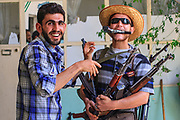 Members of the Free Syrian Army (FSA) pose for a picture following a arms induction in Anadan on Monday, June 25, 2012. Anadan bears the scars from Syrian President Bashar al-Assad's use of military force to crush an opposition movement that has spawned an armed insurgency against his rule. (Photo by Vudi Xhymshiti)