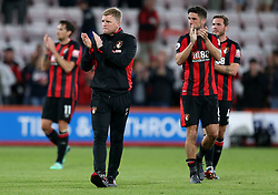 AFC Bournemouth manager Eddie Howe and Andrew Surman applaud the fans at the end of the match