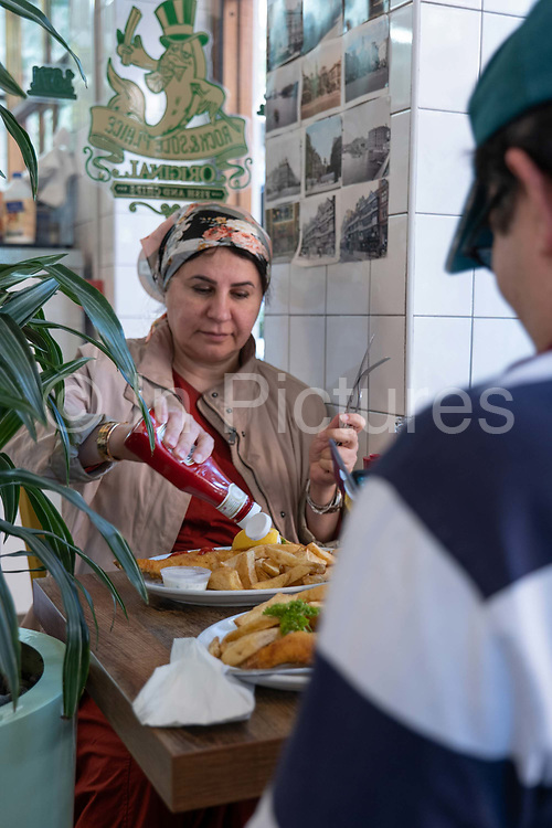 Customers at the Rock and Sole Plaice traditional fish and chip restaurant on the 27th September 2019 in London in the United Kingdom.
