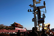 "Workers add on surveillance cameras in Tiananmen Square in Beijing, China, on 10 December 2011.  Tiananmen Square is considered the symbolic center of all China, it's significance is not lost on China's current leaders as it tightens its security and surveillance of the area to spot potential ""trouble makers"""