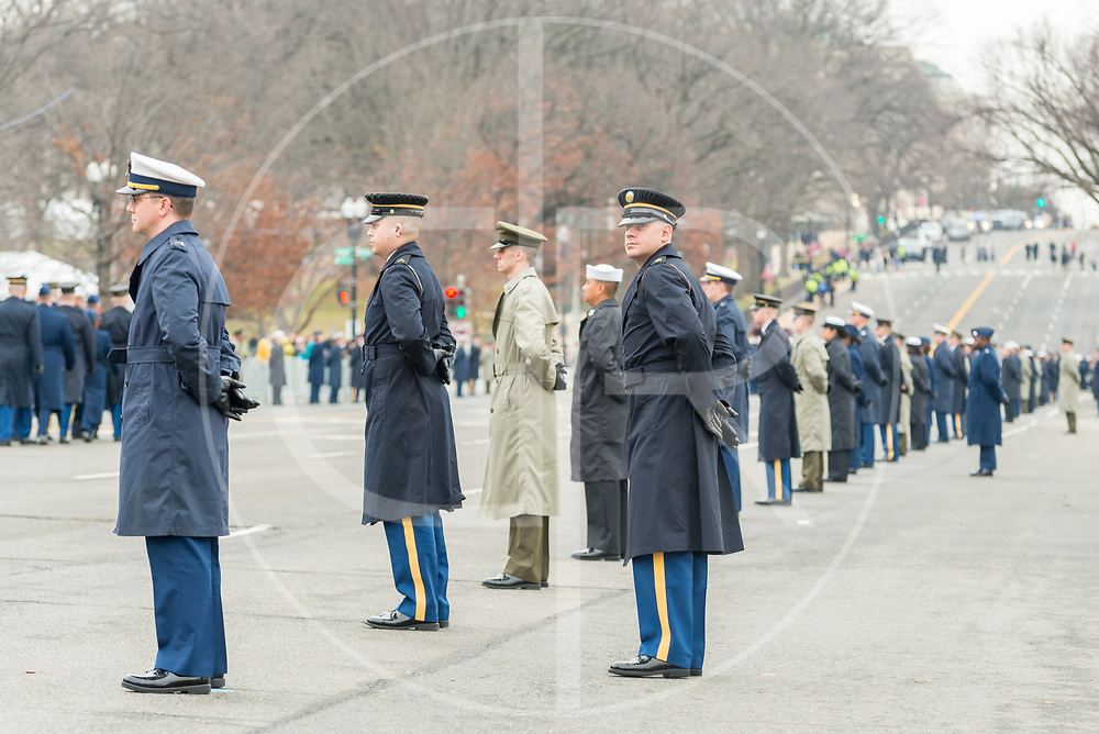 Washington DC, United States - Members of the U.S. Armed Forces get into place along Constitution Avenue, ahead of Trump's Presidential motorcade.