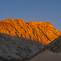 The sun rises on peaks of the Eastern Sierra Nevada above Piute Pass and North Lake, near Bishop, California.