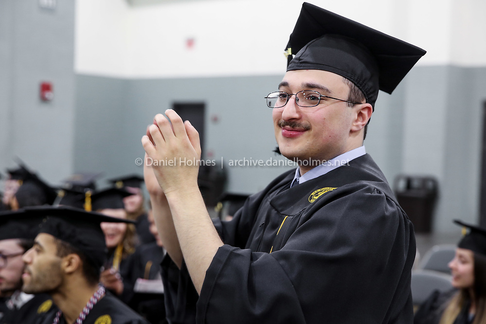 (5/26/19, WORCESTER, MA) Graduate Mark Simons, of Burlington, applauds as his classmates process during the Framingham State University's undergraduate commencement ceremony at the DCU Center in Worcester on Sunday. [Daily News and Wicked Local Photo/Dan Holmes]