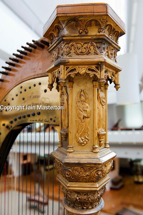 Detail of ornate harp at Musikinstrumenten Museum or Museum of Musical Instruments in Mitte Berlin Germany