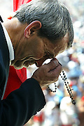 Faithful pray during a mass ceremony at the Catholic Fatima shrine in central Portugal 13 August 2005. Thousands of pilgrims converged on Fatima to celebrate the anniversary of the first apparition of the Virgin Mary to three shepherd children on 13 May 1917.PHOTO PAULO CUNHA/4SEE