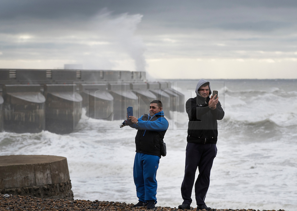 © Licensed to London News Pictures. 20/11/2016. Brighton, UK. Visitors to Brighton Marina take selfies as Storm Angus whips up the sea. The south east has experienced winds of up to 80 miles per hour as the first named storm of the season hits. Photo credit: Peter Macdiarmid/LNP