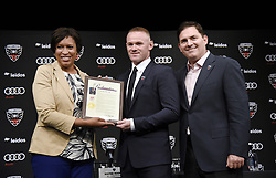 """English international soccer player Wayne Rooney flanked by Mayor of Washington, D.C. Muriel Bowser (L) and Jason Levien , United Managing Partner and CEO receives the """"Wayne Rooney Day"""" proclamation during the media unveiling at the Newseum on July 2, 2018 in Washington, DC..Photo by Olivier Douliery/ Abaca Press"""