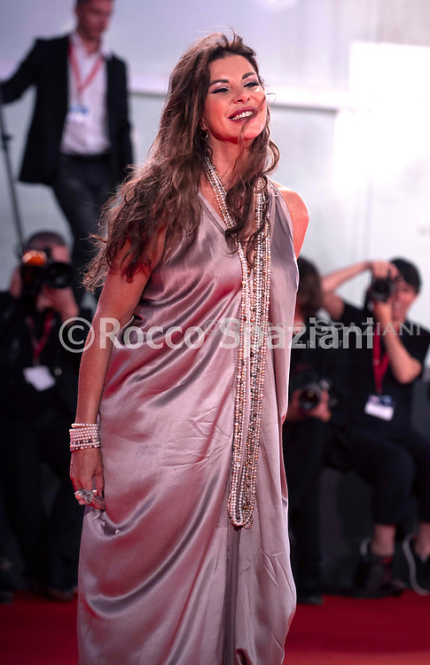"VENICE, ITALY - SEPTEMBER 05: Alba Parietti walks the red carpet ahead of the ""ZeroZeroZero"" screening during the 76th Venice Film Festival at Sala Grande on September 05, 2019 in Venice, Italy."