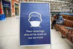 © Licensed to London News Pictures. 05/06/2020. London, UK. A 'FACE COVERINGS SHOULD BE USED ON OUR SERVICES' sign at Waterloo Station. The government has ordered that commuters will have to wear face coverings on public transport in England from 15 June. Photo credit: Dinendra Haria/LNP