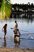 Woman, Outrigger canoe, Moorea, French Polynesia