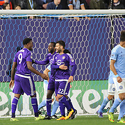 Cyle Larin, Orlando, celebrates with team mates after heading the winning goal after goalkeeper Josh Saunders, NYCFC, failed to cut out a cross, during the New York City FC Vs Orlando City, MSL regular season football match at Yankee Stadium, The Bronx, New York,  USA. 18th March 2016. Photo Tim Clayton