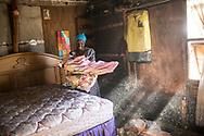 Février 2017. Afrique du sud. Les conséquences de l'exploitation des mines de charbon sur les femmes. Mpumalanga. Township de Arbor, secteur de Witbank. Elizabteh Malibe habite dans une maison collée à la mine (mbuyelo intshoveo coal). Elle vend des cadeaux aux ouvriers et aux villageois. C'est une activiste. Elle a 56 ans et vit avec son mari qui emploie des ouvriers pour faire le cloturage de la mine. Ce sujet a été réalisé avec l'aide de l'association sud-africaine WOMIN qui vise à conscientiser et aider les femmes à se battre contre l'industrie minière et ses conséquences sociales (chômage, précarité, violences conjugales...), environnementales et sanitaires.