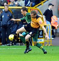 Photo: Dave Linney.<br />Wolverhampton Wanderers v Norwich City. Coca Cola Championship. 05/11/2005. Midfield tussle between Jody Craddock(Wolves) & Dean Ashton(Norwich)