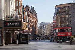 © Licensed to London News Pictures. <br /> London, UK. 24/03/2020. Empty looking Leicester Square, central London after the Prime Minister Boris Johnson announced the first coronavirus lockdown yesterday.<br /> Photo credit: Marcin Nowak/LNP
