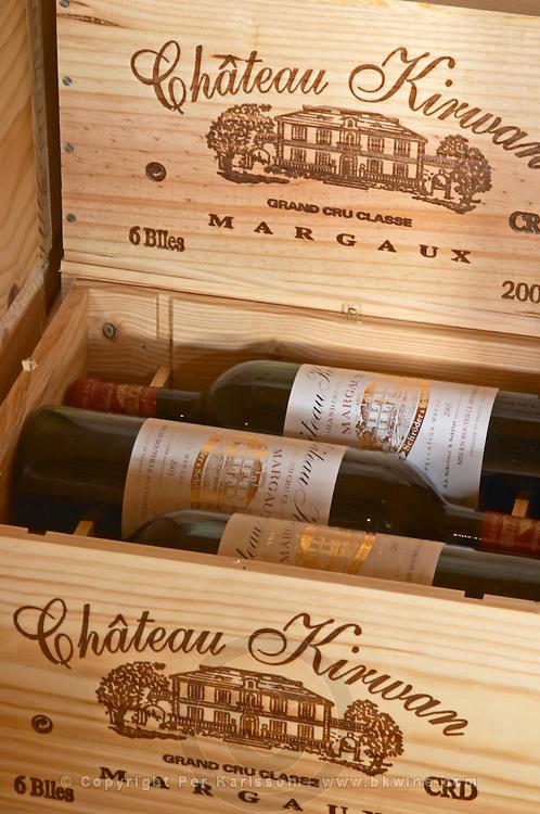 Bottles aging in the cellar. In cases. Chateau Kirwan, Margaux, Medoc, Bordeaux, France