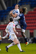 Sale Sharks wing Marland Yarde competes for high ball with Exeter Chiefs fly-half Joe Simmonds during a Gallagher Premiership Round 11 Rugby Union match, Friday, Feb 26, 2021, in Eccles, United Kingdom. (Steve Flynn/Image of Sport)
