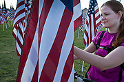 "10 SEPTEMBER 2011 - TEMPE, AZ:   JULIANNE ANDERSON, from Tempe, AZ, looks at a flag in the ""Healing Field"" in Tempe, Saturday. The ""Healing Field,"" a display of 2,996 flags, one for each person killed in the September 11 terrorists attacks on the World Trade Center in New York City and Washington DC, have become an annual tradition in Tempe, AZ. The event is sponsored by the National Exchange Club.       PHOTO BY JACK KURTZ"