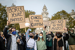 © Licensed to London News Pictures. 19/10/2020. London, UK. Hospitality workers wave placards and bang pans in Parliament Square during a protest against the impact COVID-19 restrictions are having on the hospitality industry. Photo credit: Rob Pinney/LNP