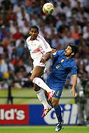 09 July 2006: Florent Malouda (FRA) (7) plays the ball, challenged by Gennaro Gattuso (ITA) (8). Italy tied France 1-1 in overtime at the Olympiastadion in Berlin, Germany in match 64, the championship game, of the 2006 FIFA World Cup Finals. Italy won the World Cup by defeating France 5-3 on penalty kicks.
