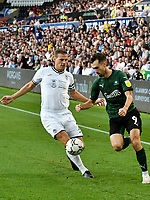 Football - 2021 / 2022 EFL Carabao Cup - Round Two - Swansea City vs Plymouth Argyle - Liberty Stadium - Tuesday 24th August 2021<br /> <br /> Ryan Hardie Plymouth Argyle on the attack Ryan Bennett Swansea City defends <br /> <br /> COLORSPORT/WINSTON BYNORTH