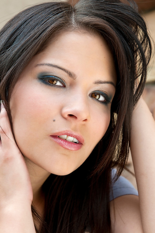 Portrait of young brunette taken outdoors in natural light.