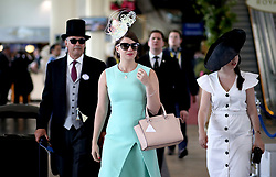 Fashionable racegoers arrive during day two of Royal Ascot at Ascot Racecourse.