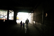 A family walks through the battery factory in Potocari, a part of the Genocide memorial center...Matt Lutton for The International Herald Tribune..Capture of Ratko Mladic. Srebrenica, Bosnia and Herzegovina. May 29, 2011.