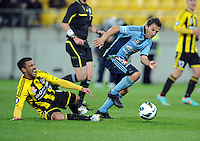 Sydney FC's Alessandro del Piero runs around the Phoenix's Manny Muscat in the A-League foootball match at Westpac Stadium, Wellington, New Zealand, Saturday, October 06, 2012. Credit:SNPA / Ross Setford