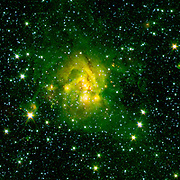 This image shows an outflow of gas from a new star as it jets from a space object dubbed IRAS 21078+5211. Spitzer.