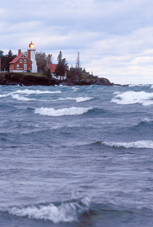 The Eagle Harbor Lighthouse in Eagle Harbor, Mich. and a stormy Lake Superior.