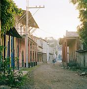 A local waling through an empty street in Jacmel, Haiti