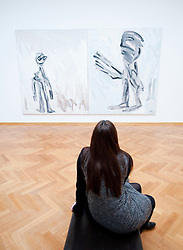 Woman looking at painting Encounter with God by Karel Appel at the Gemeentemuseum in The Hague, Den Haag,  Netherlands